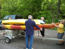 My host family unloading kayaks off truck.